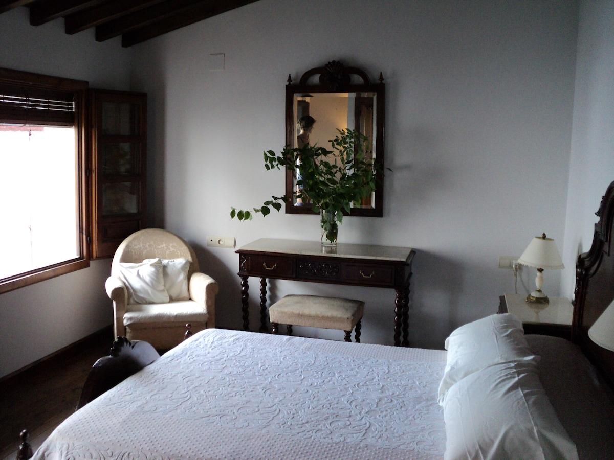Bedroom with three windows to quiet garden.