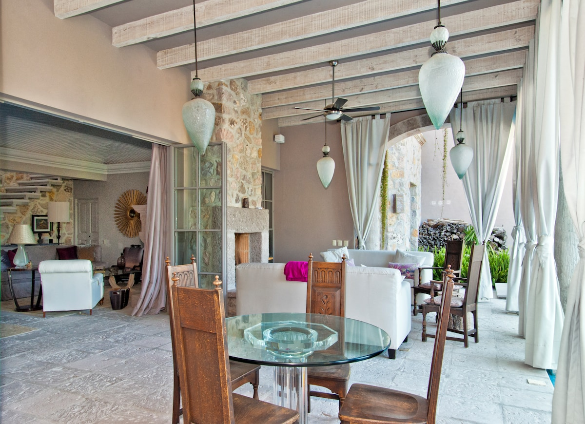 Open concept indoor outdoor living and dining.