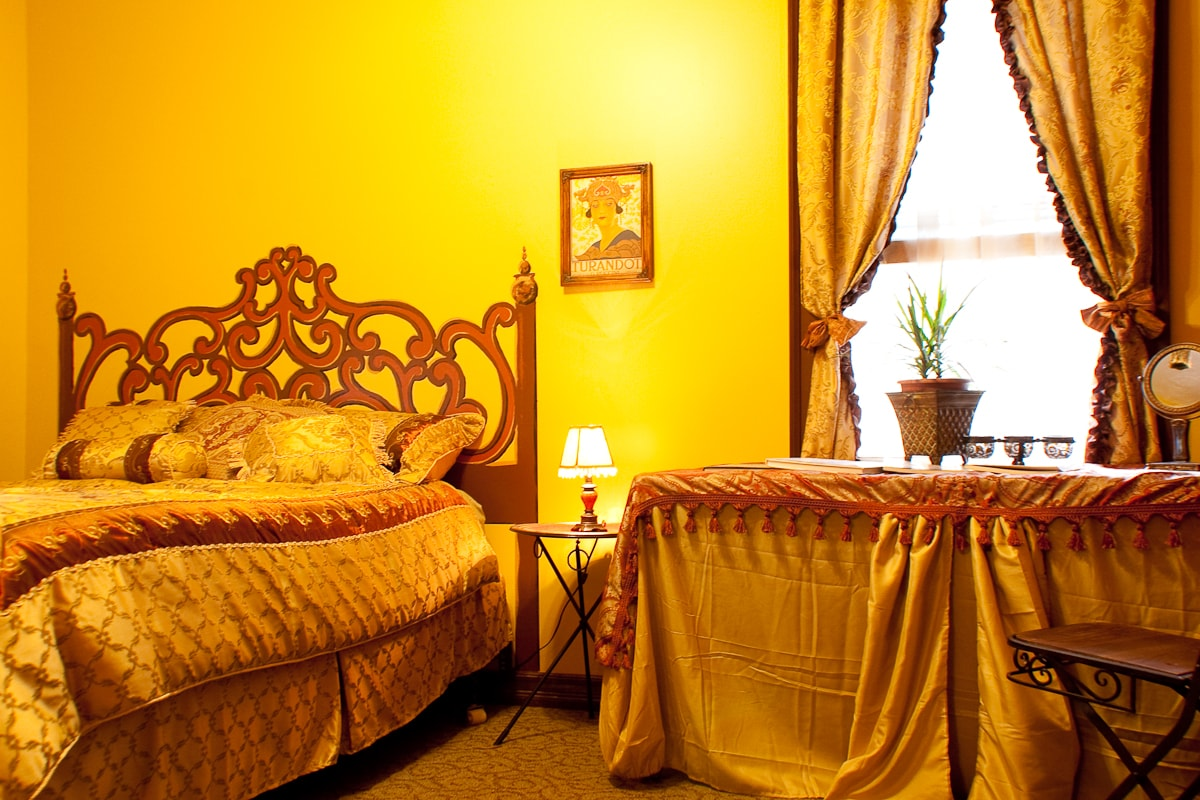 A queen size bed is in the Opera bedroom.