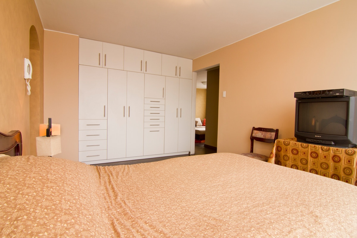 Deluxe master suite with custom built-in closet.