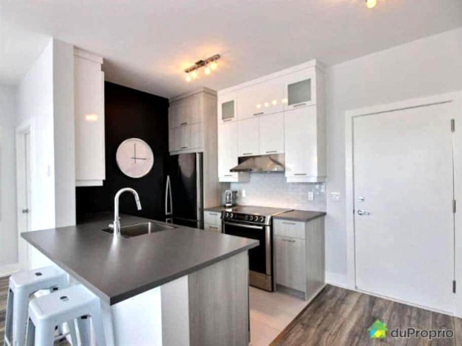 Magnifique condo neuf situé dans le DIX30 - Brossard