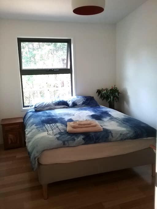Private bedroom in modern house overlooking water - Snug