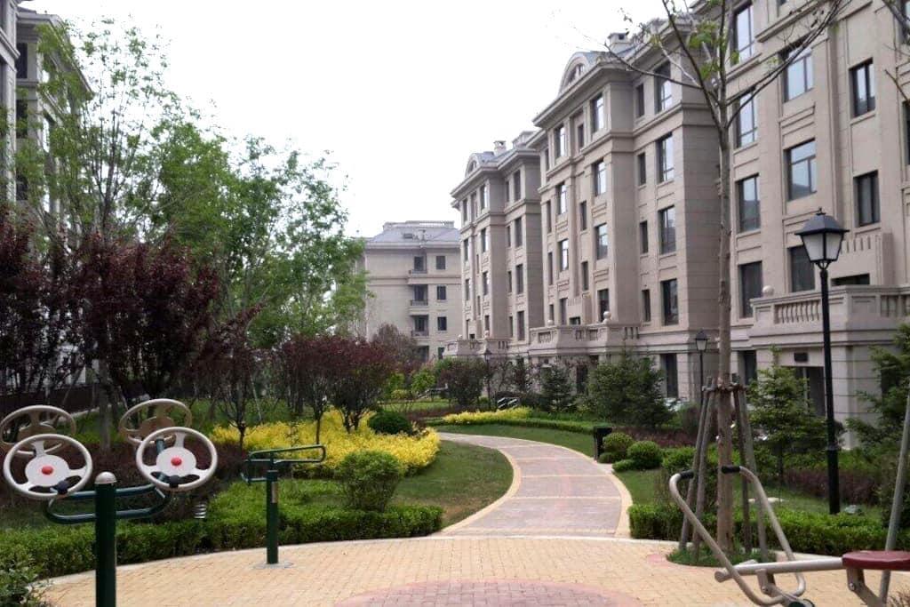 青苹果家庭旅馆 - Dalian - Hus