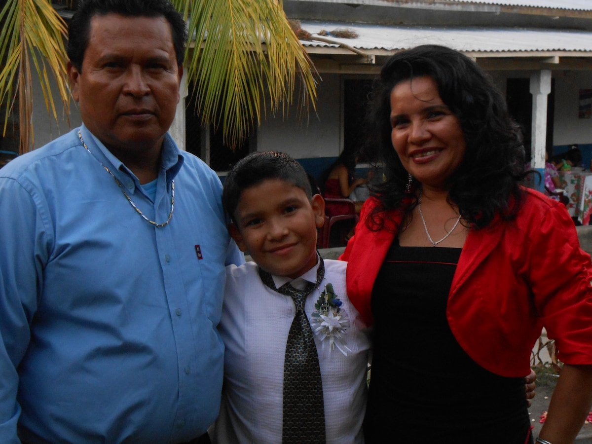 Isabel and Hector Castillo and their 2 children ar