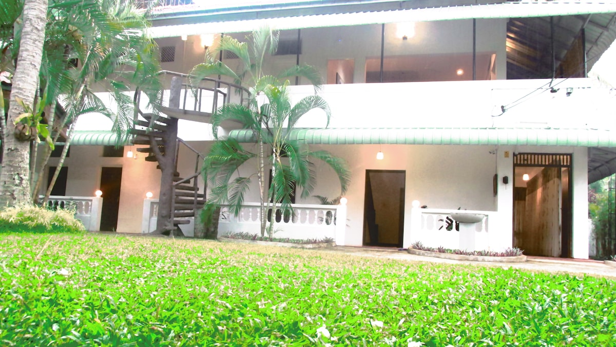 It's a typical villa type of guest house with 8 do