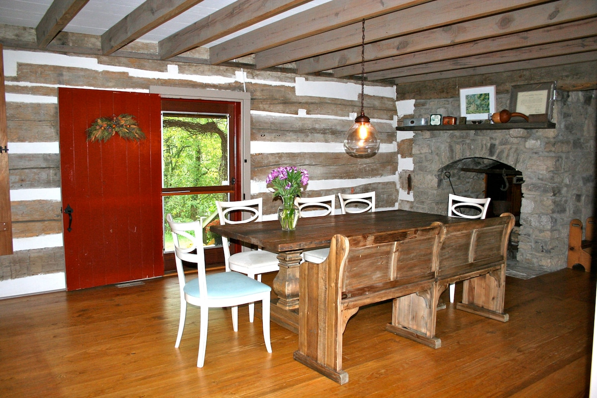 central downstairs room (dining room), made from old rebuilt log cabin. front door leading to porch.