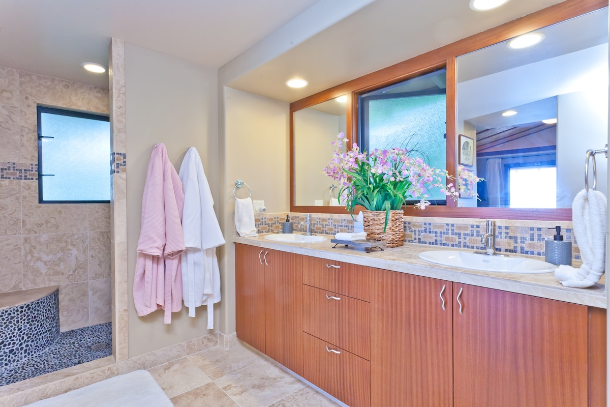 Master Bath with walk in shower and private alcove for the commode.