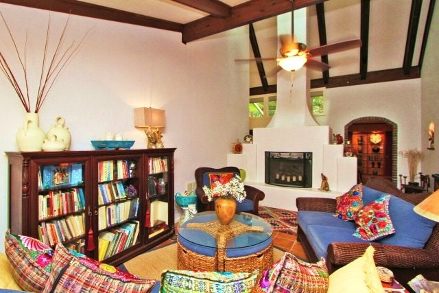 Curl up with a good book by the fireplace in living room.