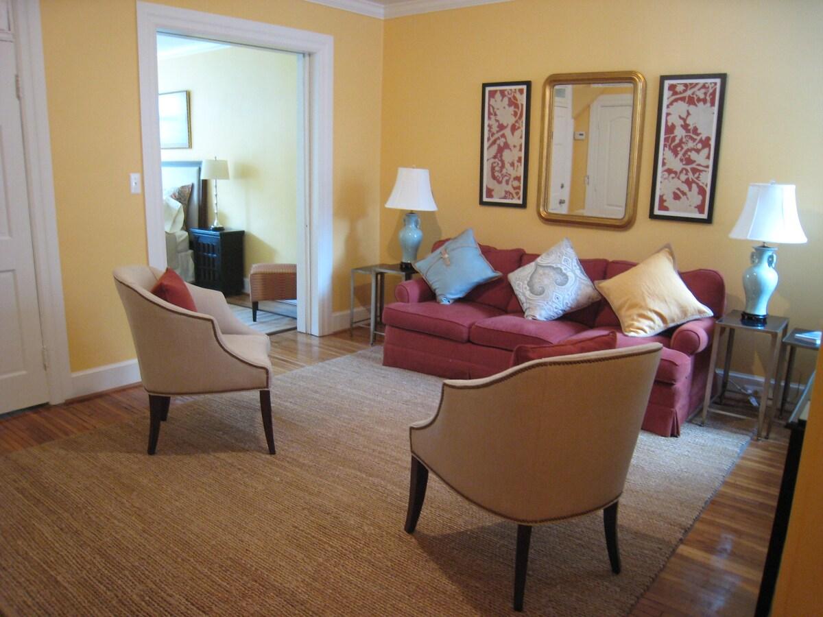 Living room with view to bedroom. Pocket doors close off bedroom.