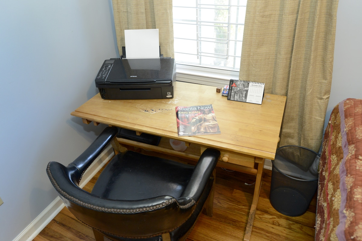 Bedroom includes workspace and printer