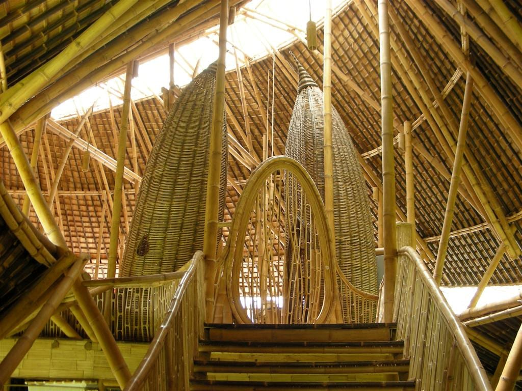 Walking up the steps to the entrance reveals remarkable all natural architecture.....Look at the oval bamboo front door