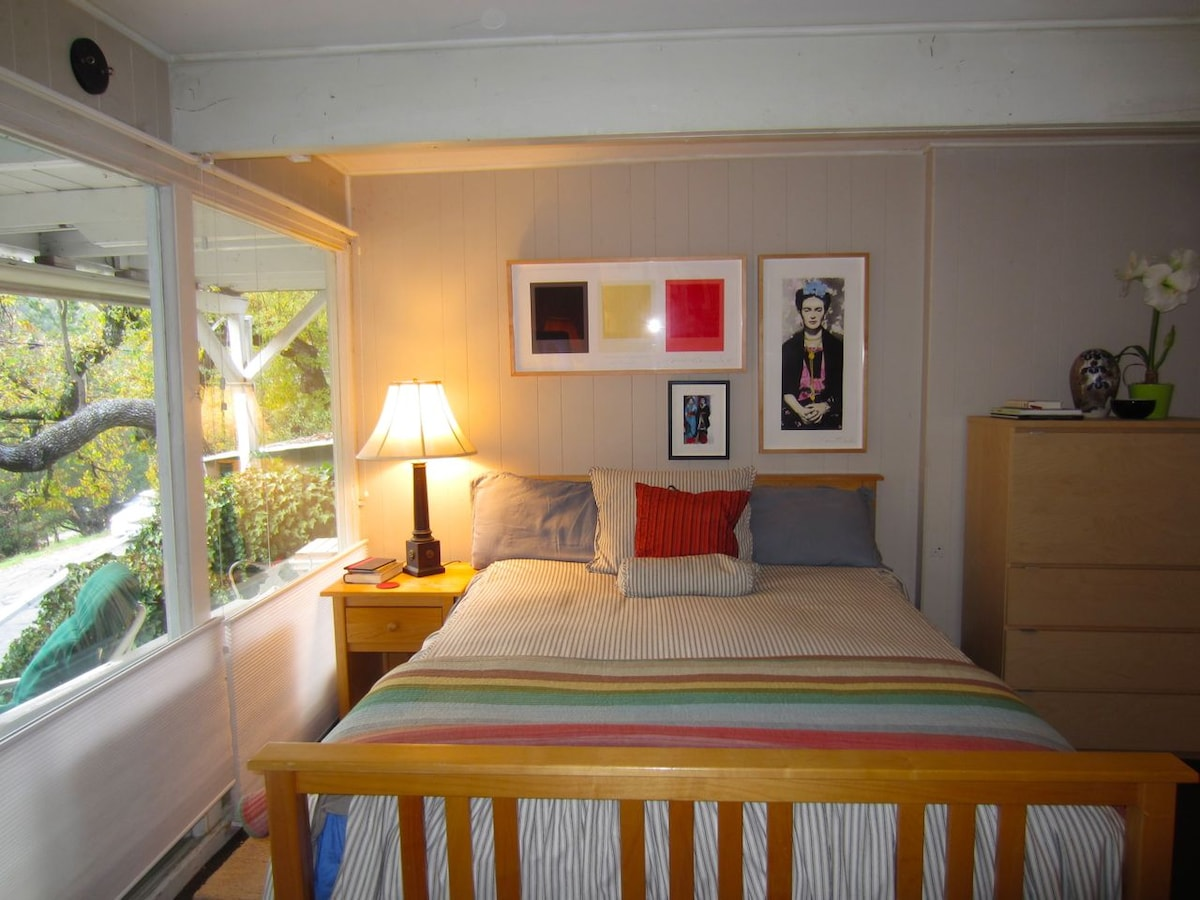 A view of the sleeping area - all the window shades go up or down