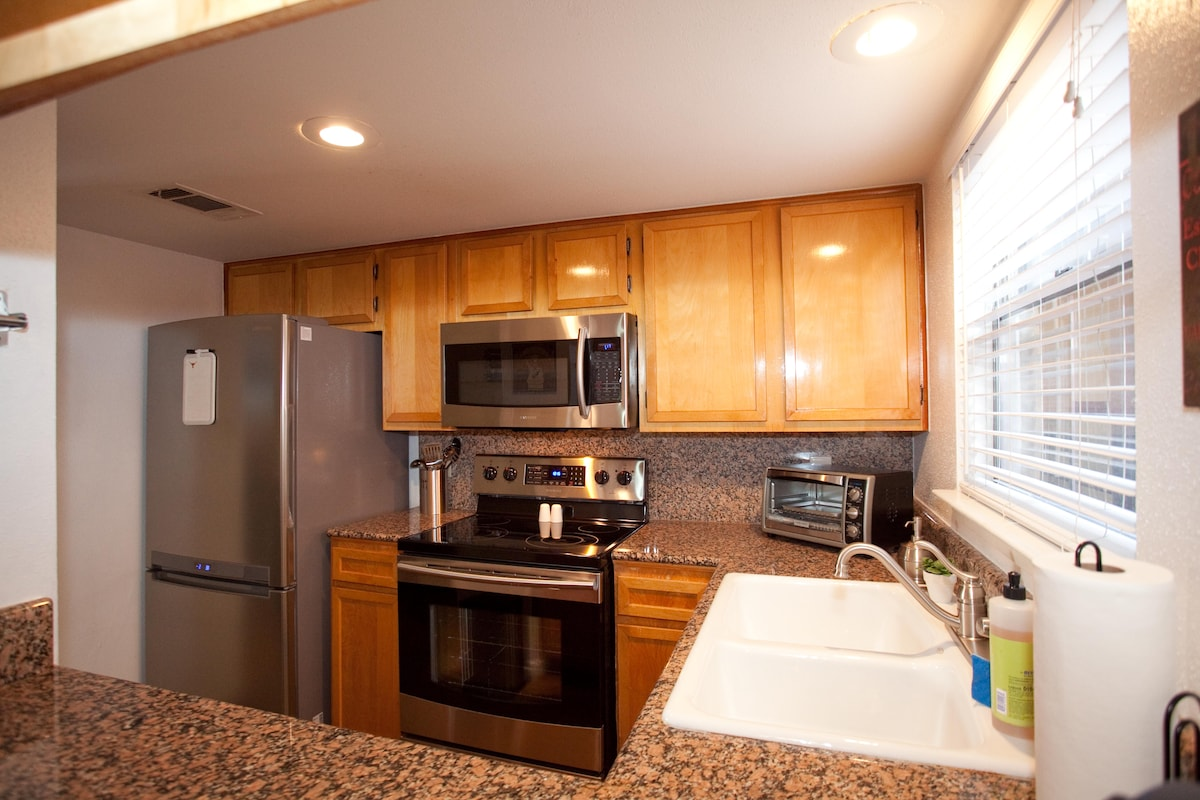 Full Kitchen with Granite Countertops and Stainless Appliances.