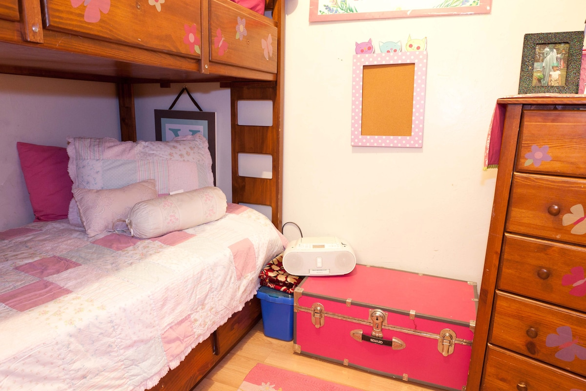 Twin size bunk beds in 1 of 3 bedrooms