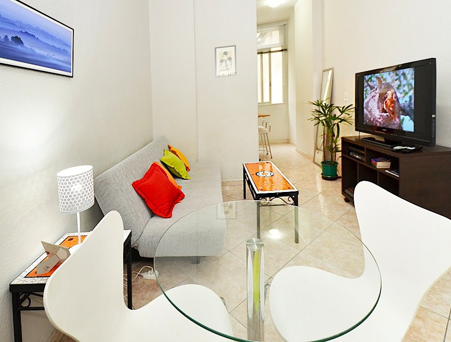 "Wide view of the living/dining, showing folding sofa/bed and the Sony Bravia 42"" LCD HDTV -"