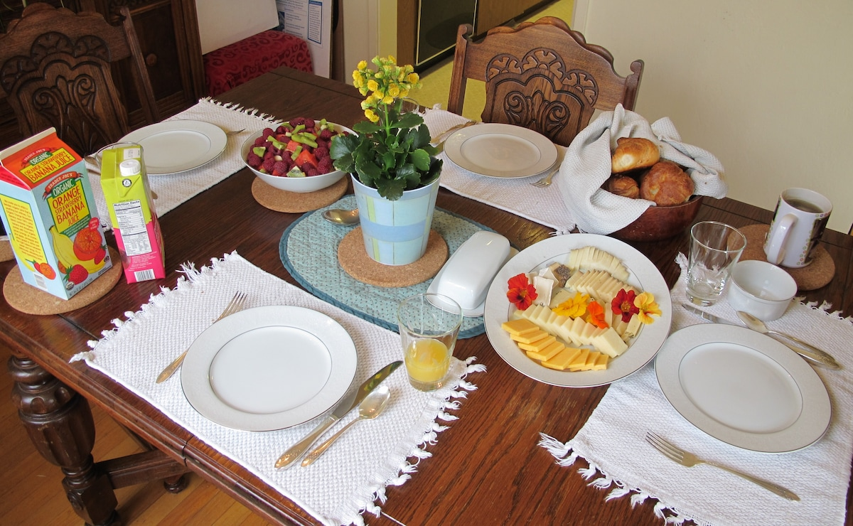 Breakfast is usually cheese, croissants or fresh baked bread, fruit salad, coffee or tea, yogurt, juice, and more!  If you read our reviews, many people LOVE our breakfast :-)