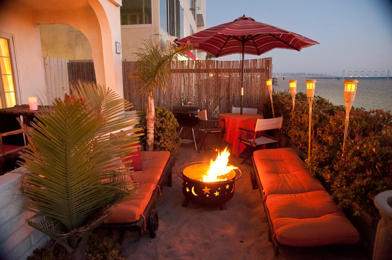 Our outdoor living room right ON THE SAND!!! Sun lounge chairs, outdoor dinning table with umbrella, BBQ and solar tiki torches. A great place for any meal and wireless internet for your laptop!