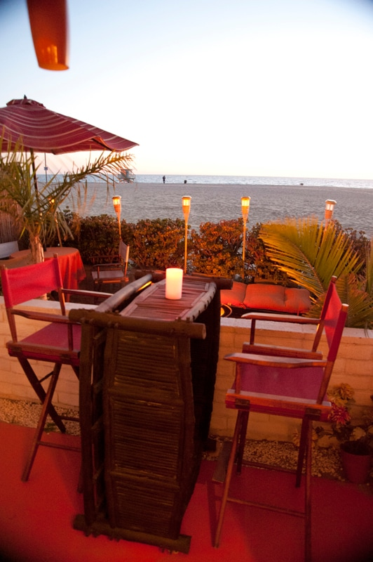 Enjoy a glass of wine at sunset or your morning cofee from the covered patio or the open air sand patio. on the View from covered patio w/dining bar overlooking beach.