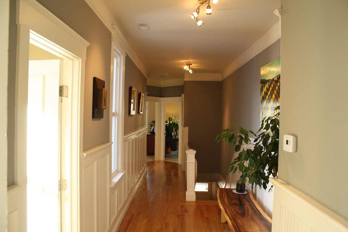The hallway looking down to the bedrooms on the west side of the house.