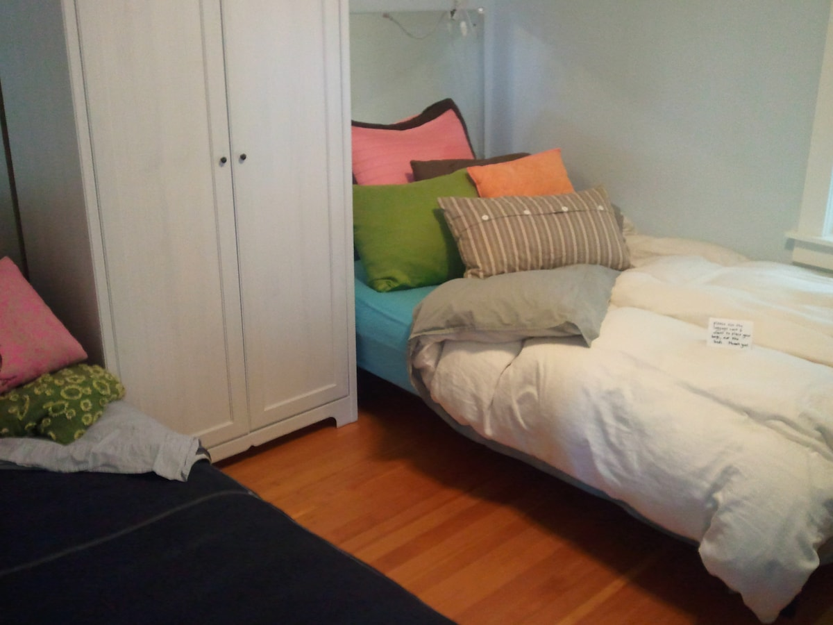 this cozy, quiet, dark room has a long double bed (on right) and a chaise lounge, which folds into a long but narrow single bed (on left).