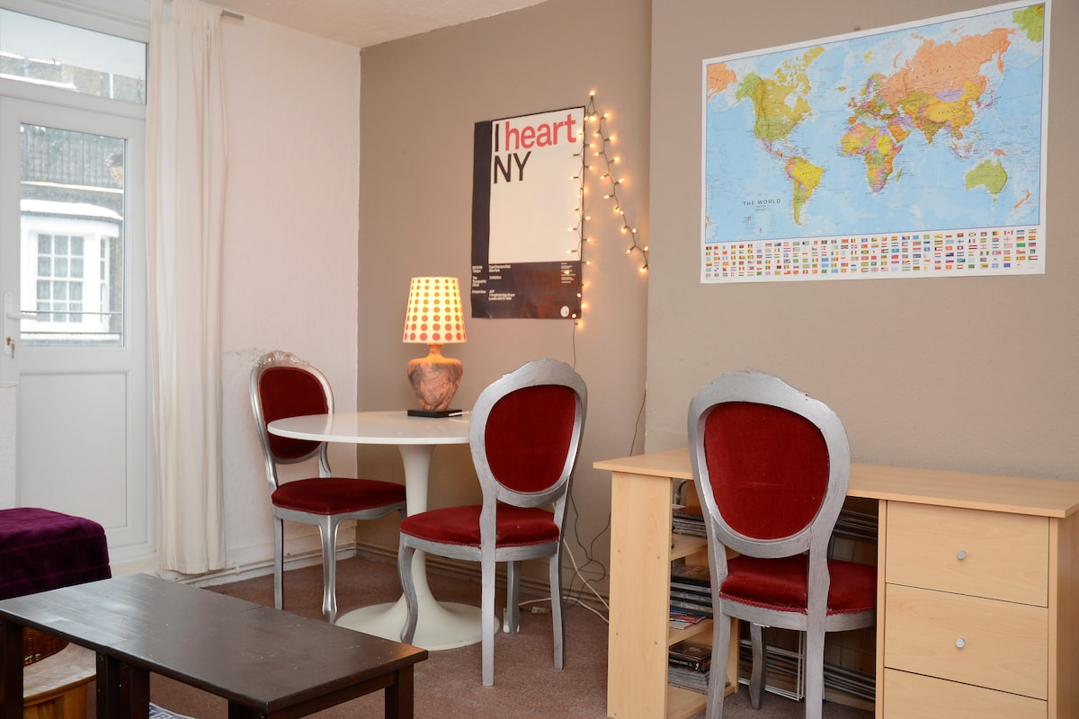 The living room is great for relaxing. And maybe get ideas for your next trip on the world map.