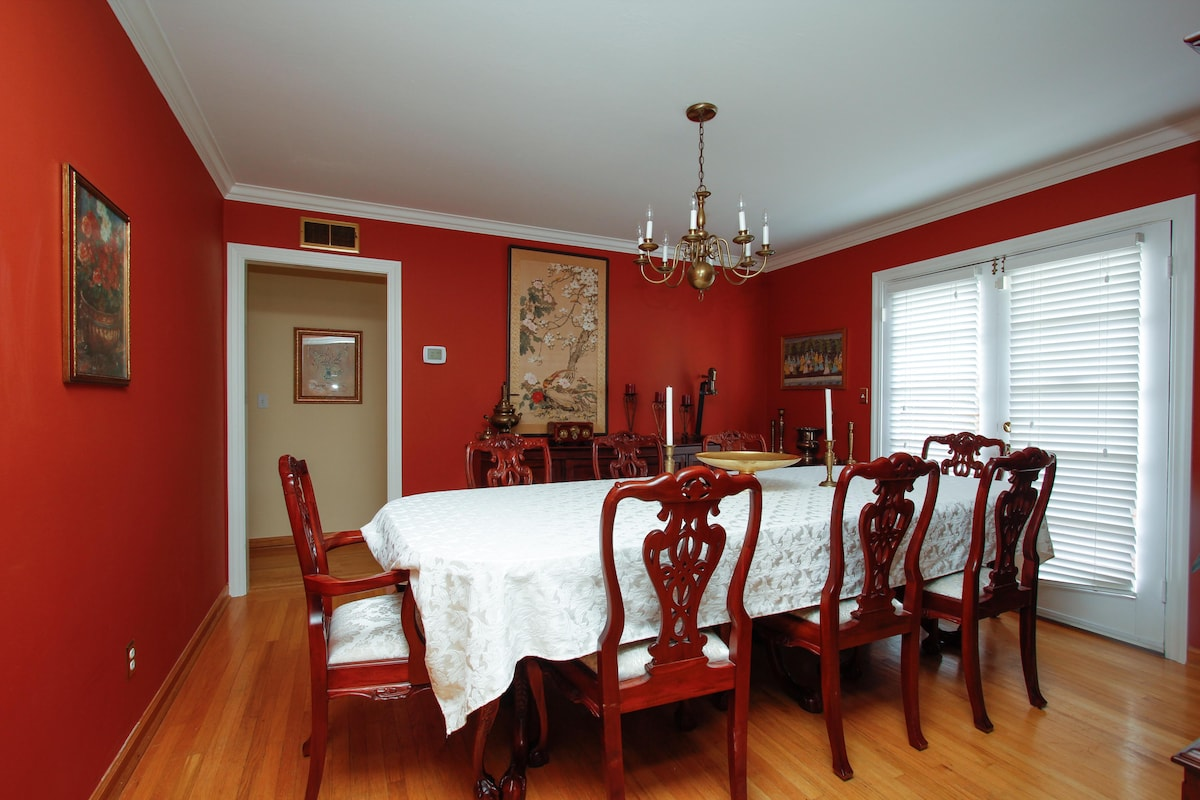 Formal Dining Room with antique cherrywood table, china cabinet and buffet