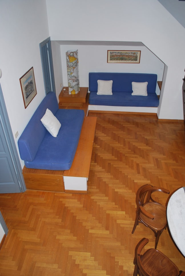 Two Sofa - bed in the living room; on the left the door to the kitchen and to the bedroom.