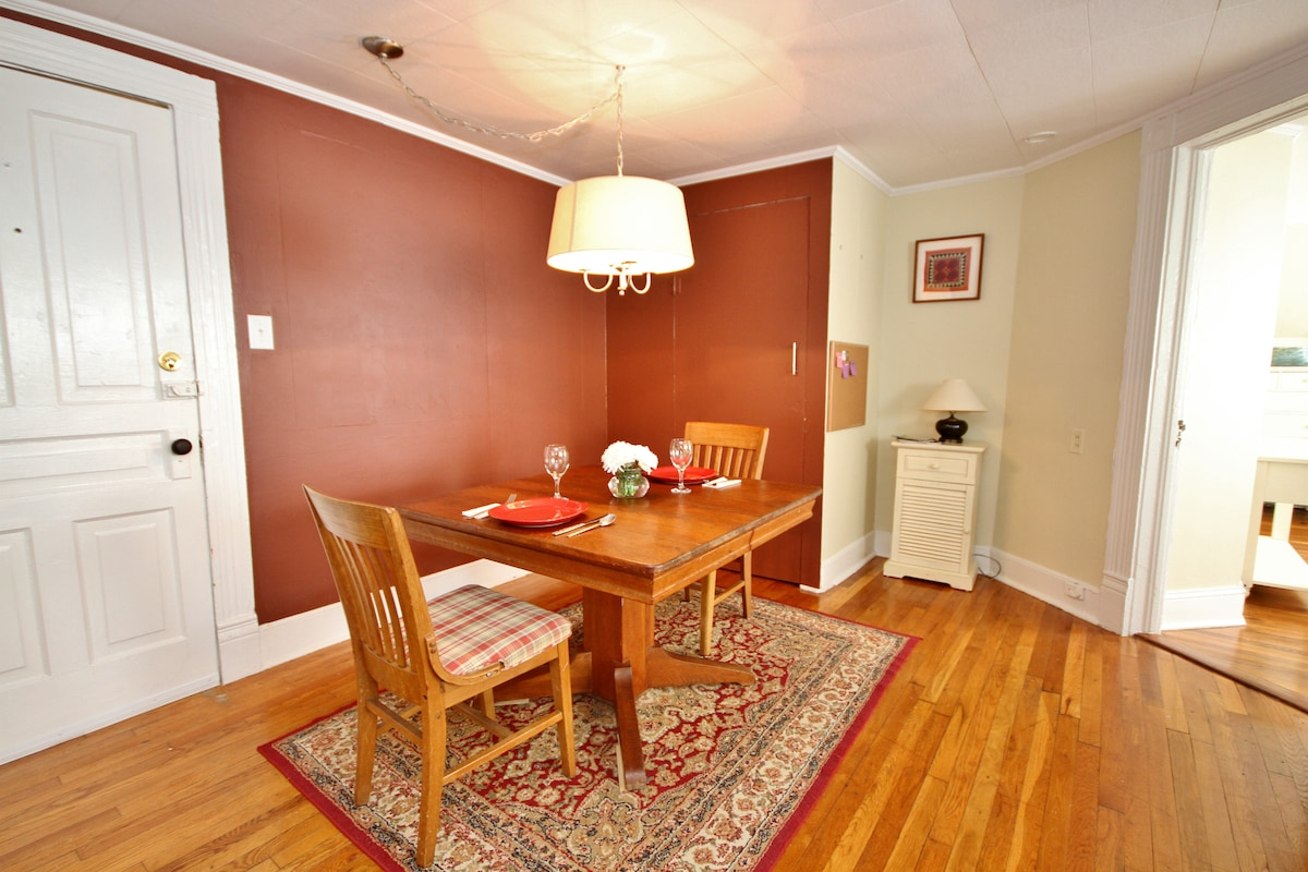 The dining area can accommodate four with extra chairs.