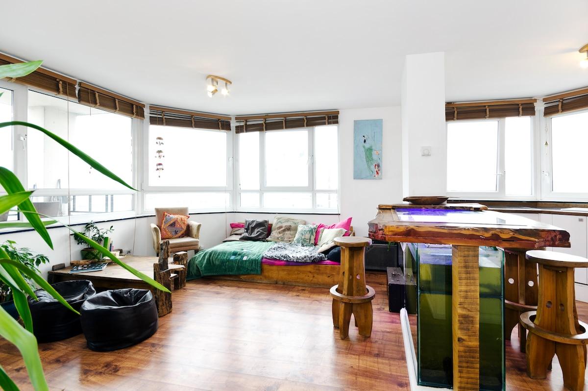 Living space with handmade artisan furniture, original artworks and aquarium table!