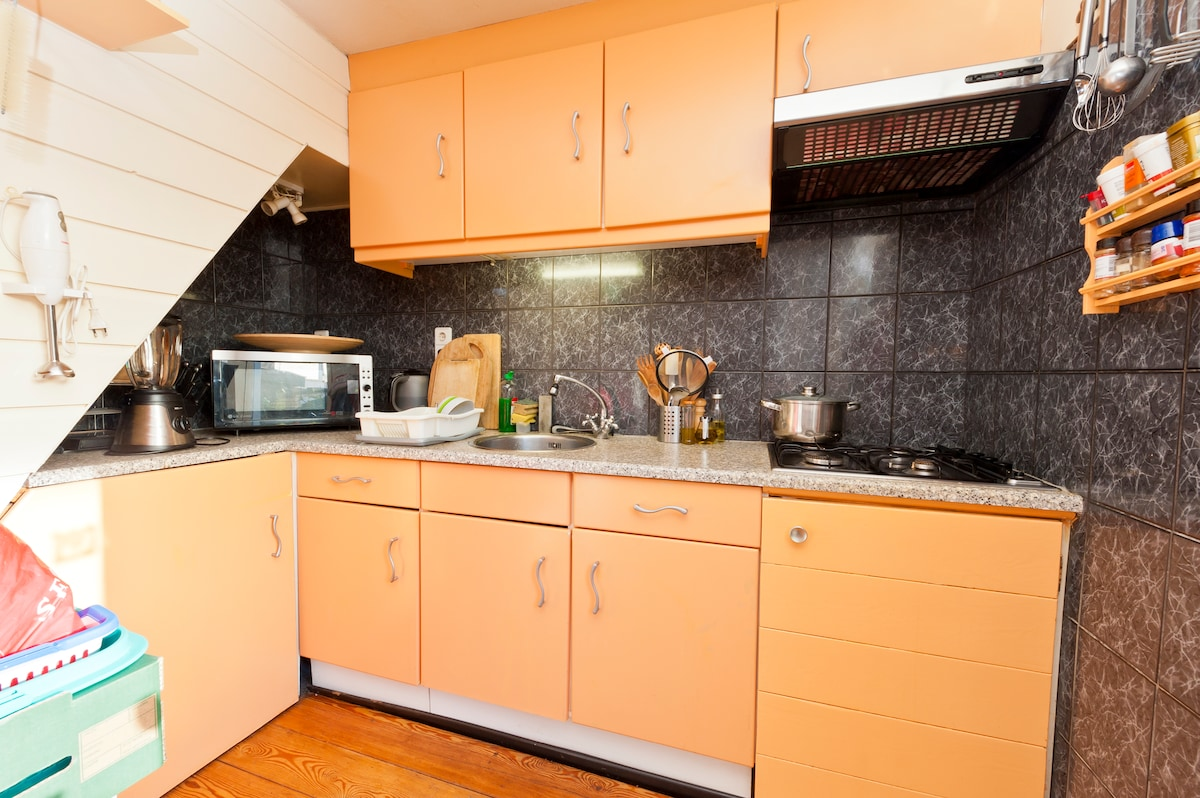 Kitchen with stove, microwave, blender