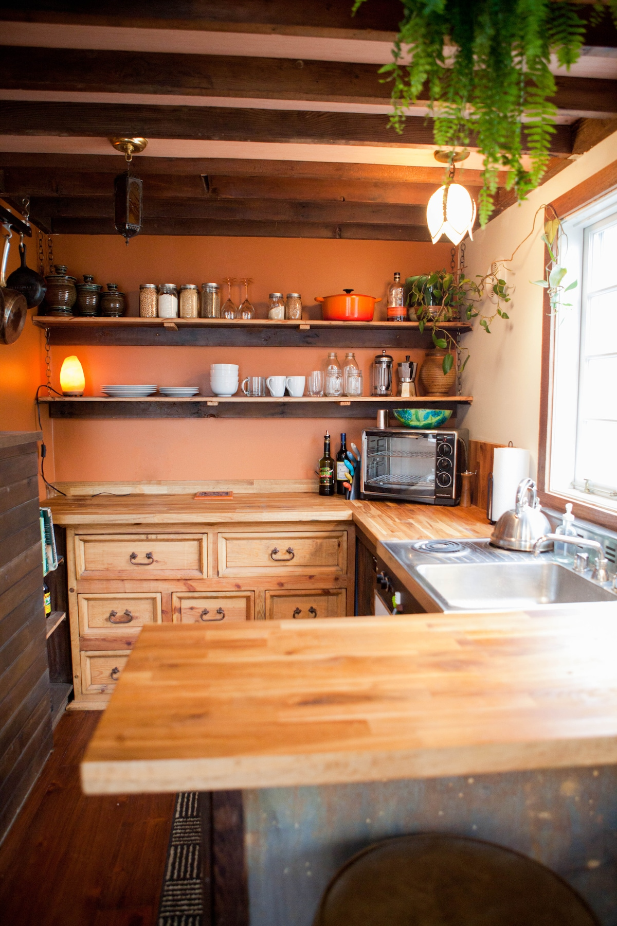 Kitchen with lots of storage, stove, sink, counter-height refrigerator/stove, sink, and convection oven.