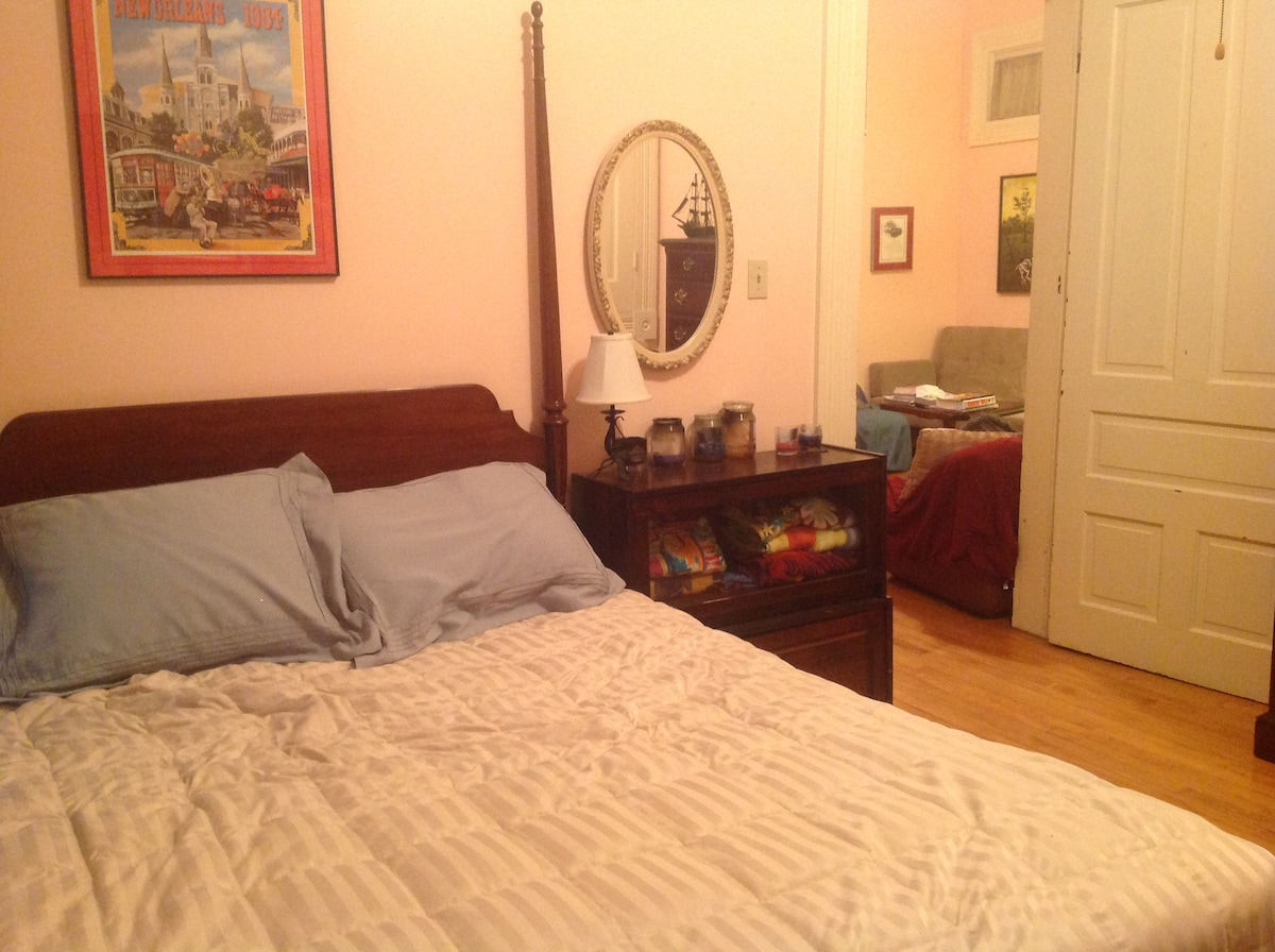 Queen size bed with window to the left for natural light, plenty of closet space, door shuts.