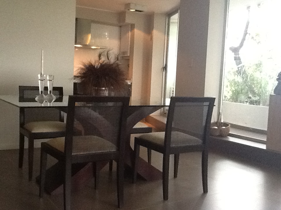 The open plan apartment has a formal dining room for four.