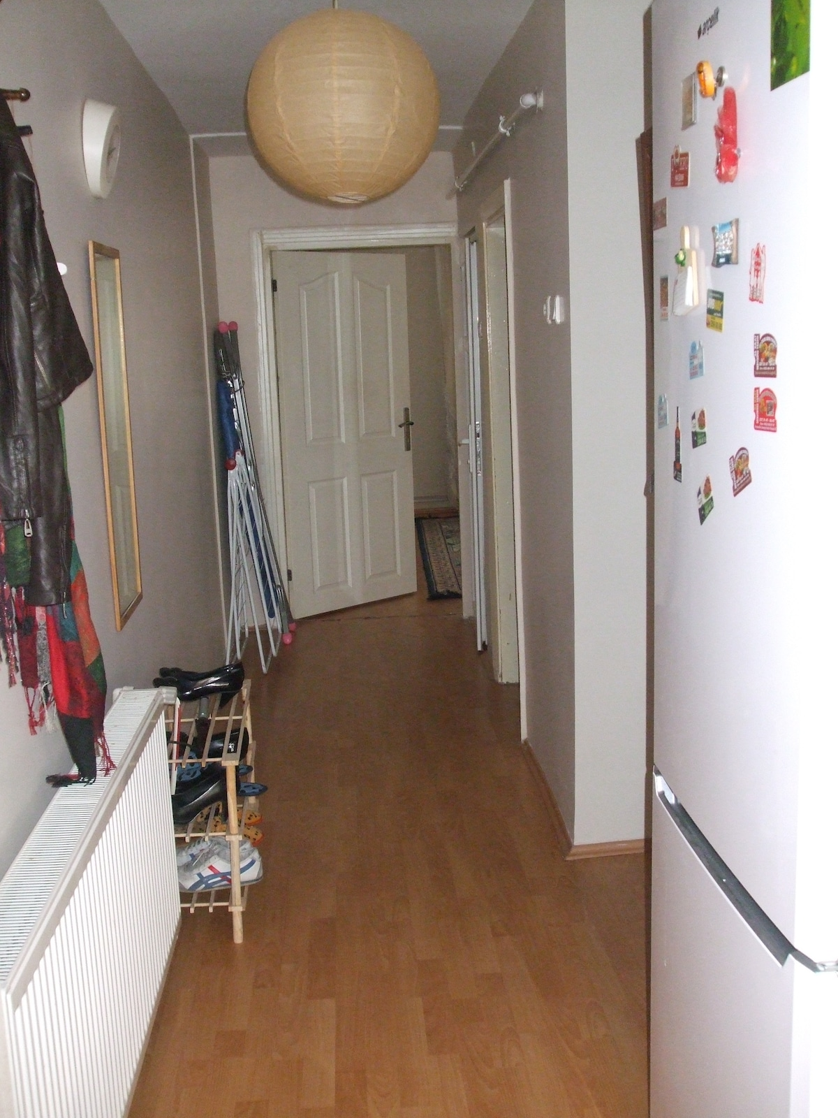 The hallway from opposite direction, fridge is in hallway. Guests are free to use it.