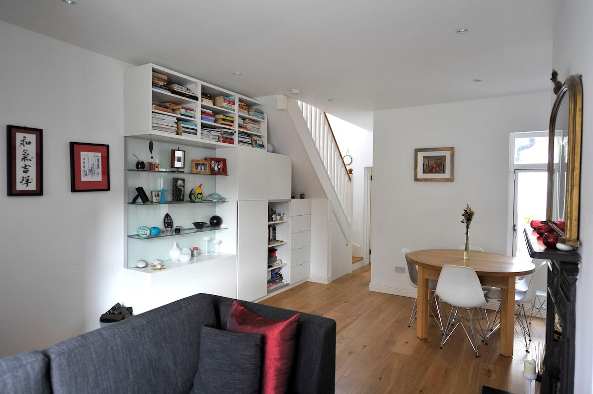Livingroom/ Diningroom.  Bright room.  Victorian fireplace. Contemporary decor.