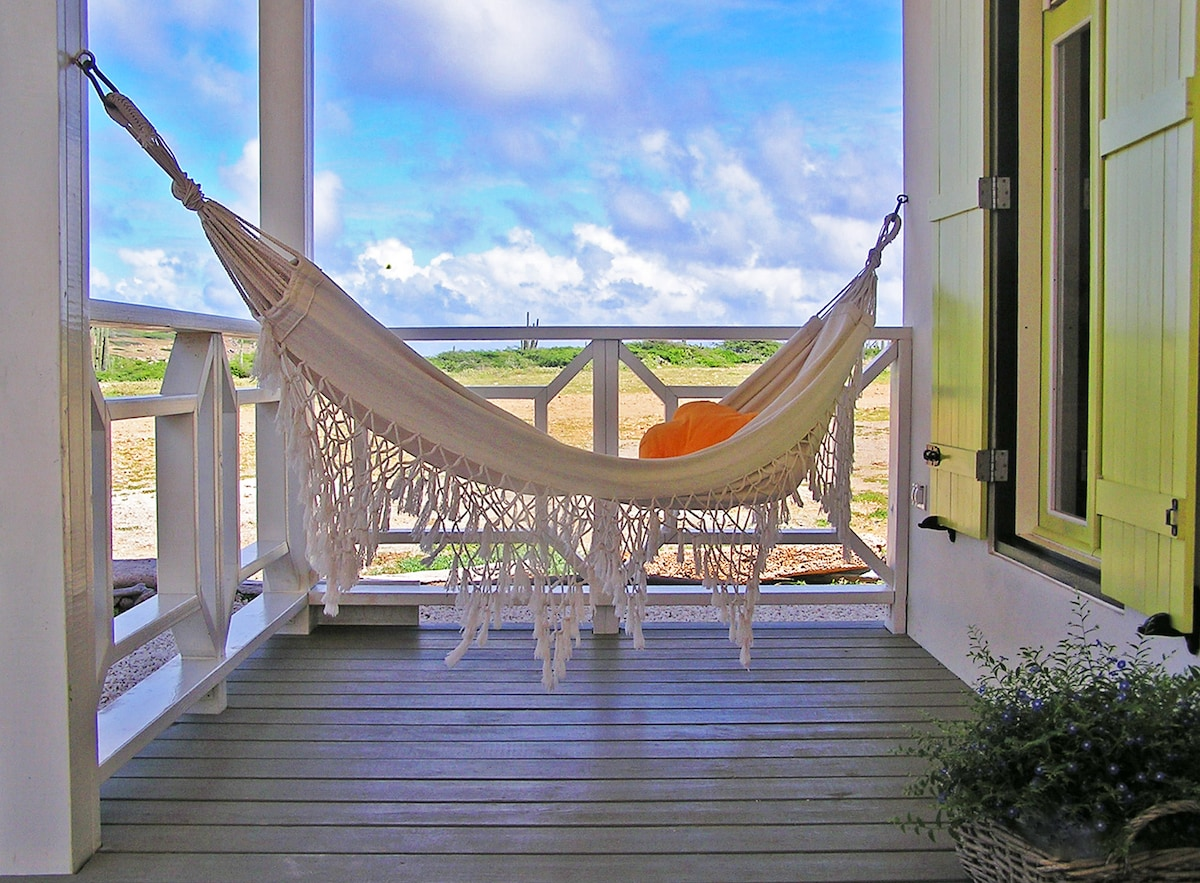 Laze away in your own private hammock with the distant sound of the waves