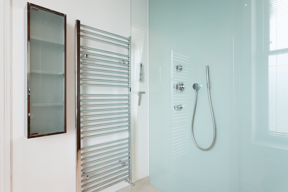 Separate handheld shower which operates independently to the overhead shower. In case you don't want wet hair :)