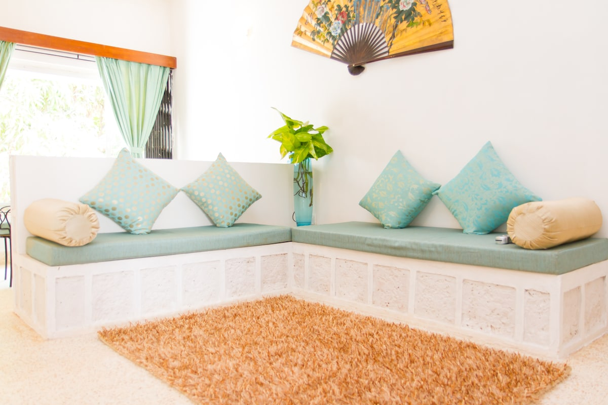Turquoise Haven with Cozy Comforts