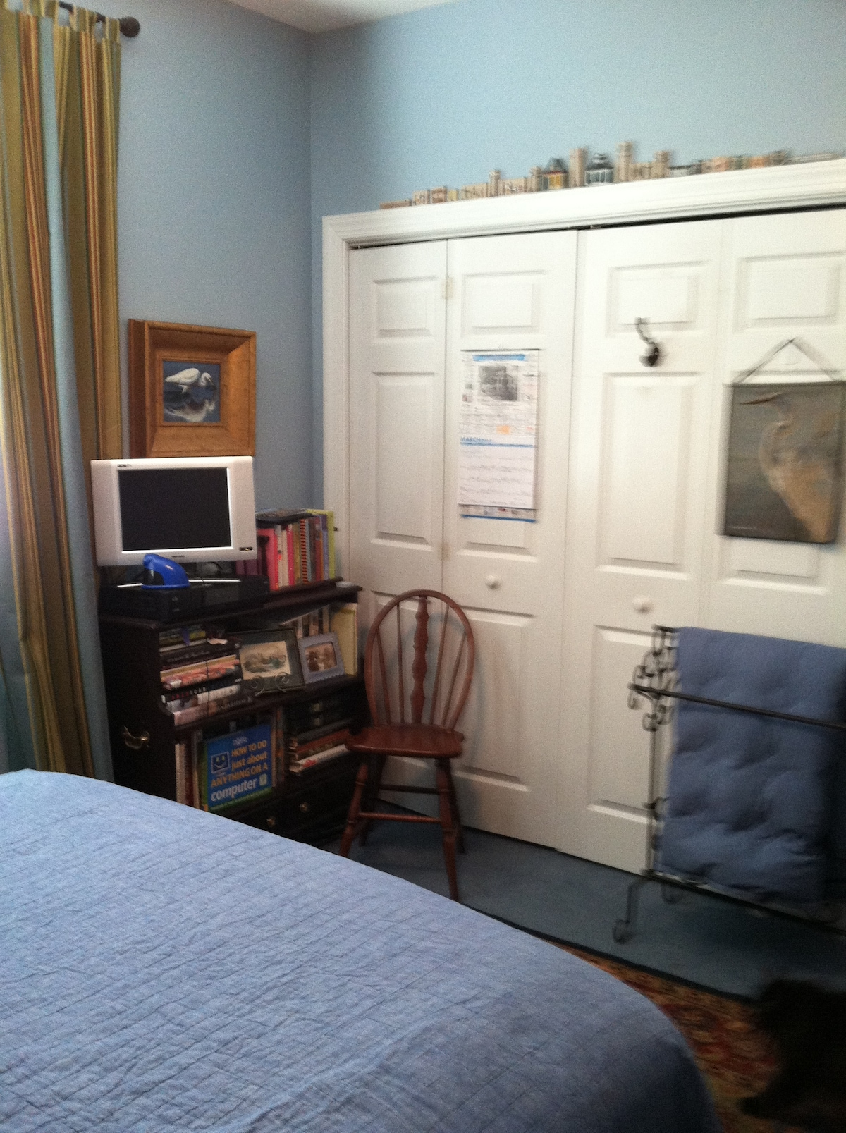 The LCD television & closet.