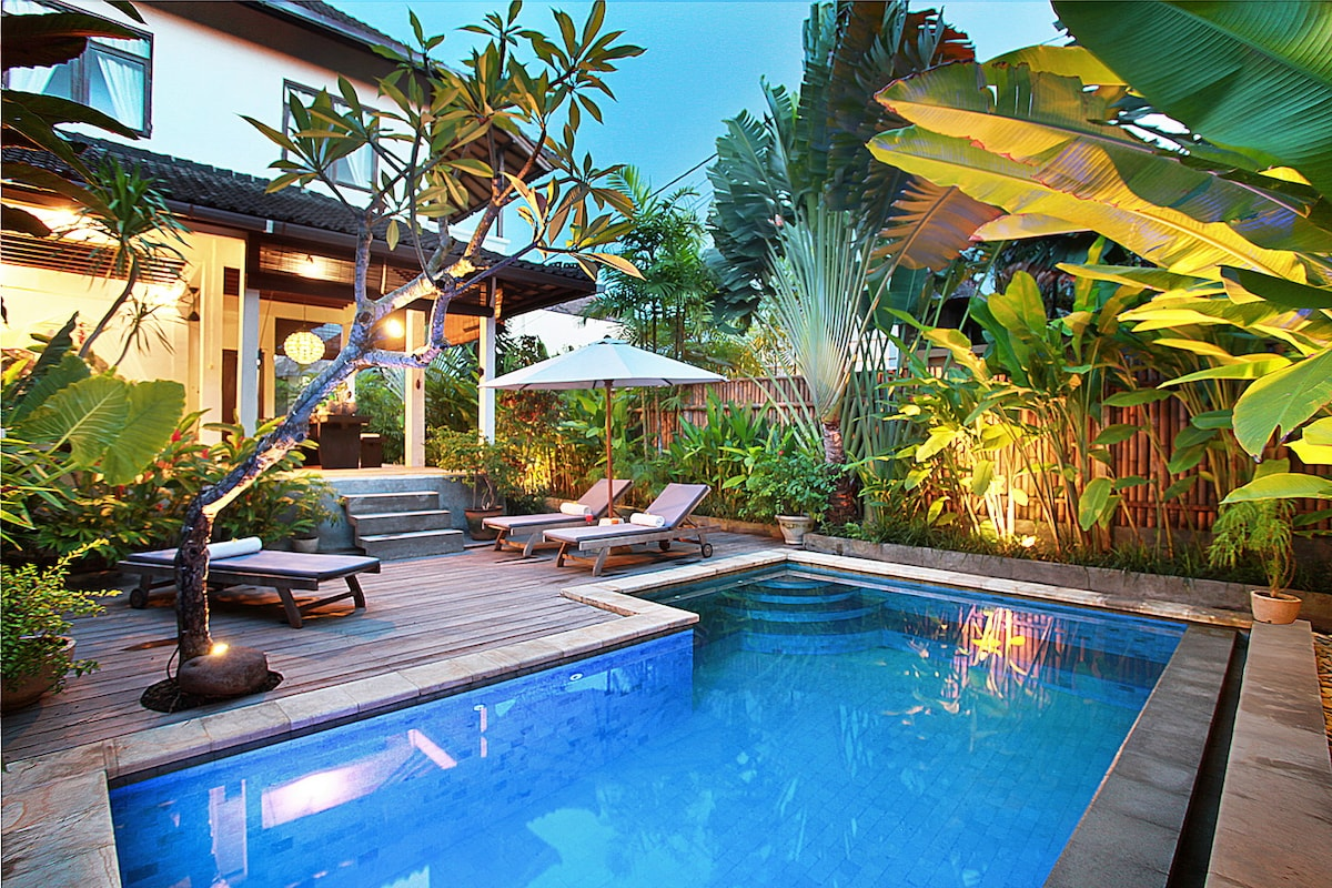 Private pool enclosed by lush tropical garden.