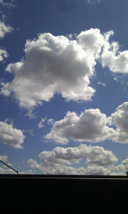 Lying back on the couches on the balcony trying to grab the clouds passing by!