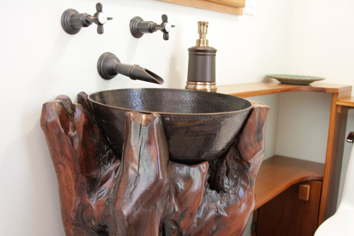 The bathroom has a Jacuzzi bathtub and handcrafted sink you'll always remember