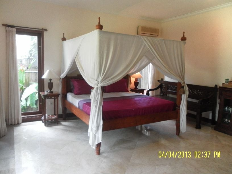 Antique furnished marble floor bedroom with AC. Our room is completely private, with its own access direct to the large tropical garden