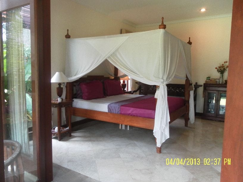 The bed is King size, & very comfortable. View of our bedroom as seen from the French garden doors
