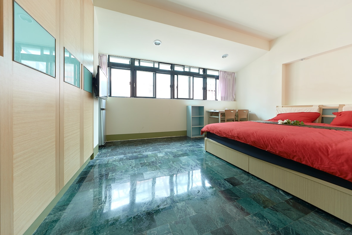 A spacious room with a HUGE bed