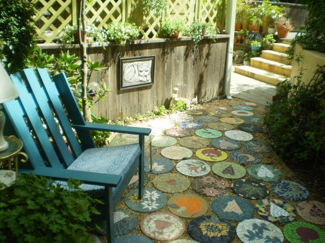 Step down into your private patio, with Kathryn's mosaic paving.