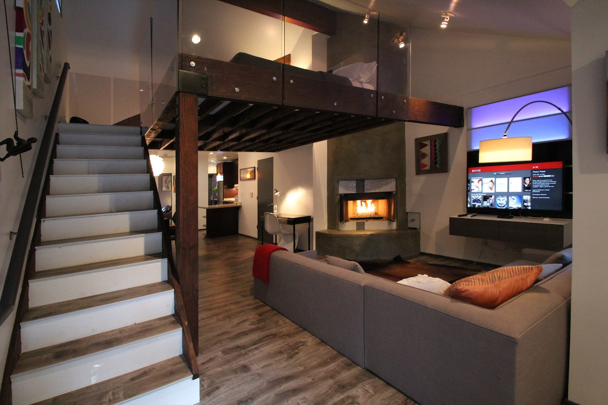 """Living Area with a cozy fire and a 46"""" LED smartTV with NetFlix & DirectTV choice channels"""