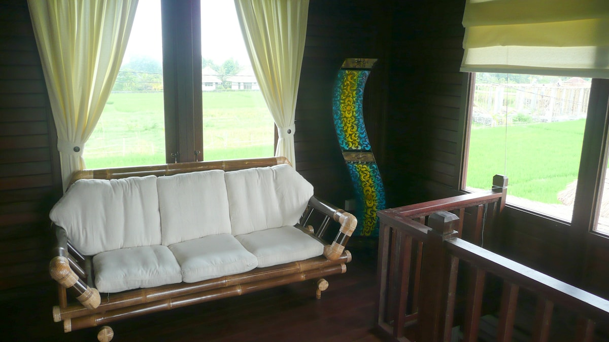 Upstairs living area with balcony and rice field views on 3 sides