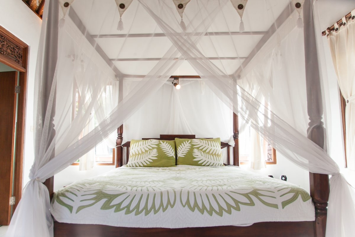 Fall asleep like a princess (or prince)! Large airy bedroom with vaulted ceiling and mosquito net.