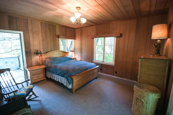 master bedroom. queen bed, one shared porch, one private porch.